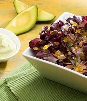 Red Leaf Salad with Candied Pineapple, Spiced Pepitas, and Avocado Dressing