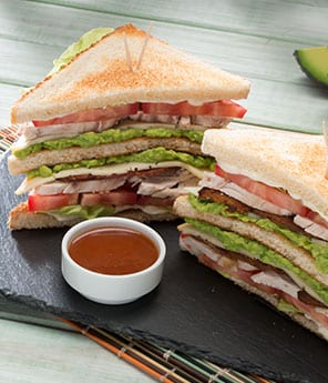 Triple-Decker Turkey Club with Zesty Avocado Ranch Spread