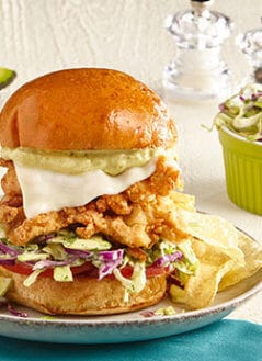 Curry Fried Chicken Sandwiches with Spiced Avo-Mango Aioli and Cilantro-Lime Avocado Slaw