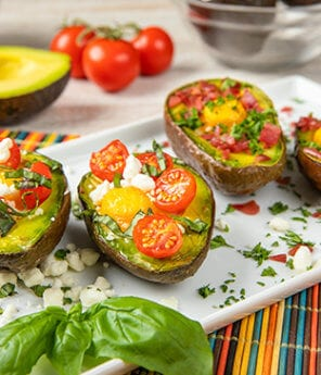 Baked Avocado Eggs with Cherry Tomato, Goat Cheese and Basil