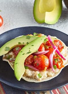 Mex-Med Tostadas with Avocado, Cannellini Beans, and Roasted Cherry Tomato Salsa